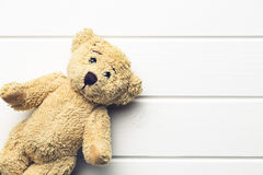 Teddy bear on white table Stock Image