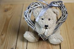 Teddy bear with wicker heart. stock images