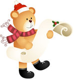 Teddy bear with wishlist for christmas on a parchment Royalty Free Stock Photo