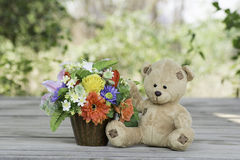 Teddy Bear With Flower Vase Royalty Free Stock Photo