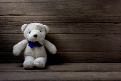 Teddy bear  on wood background, still life Stock Photography