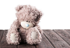 Teddy bear on wood desk Royalty Free Stock Images