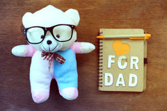 Teddy bear and wooden alphabet letter forming the text FOR DAD Royalty Free Stock Photo