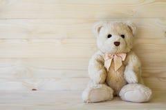 Teddy Bear on wooden floor Stock Photo
