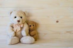 Teddy bear on wooden floor Stock Images