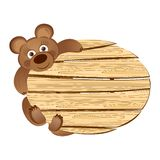 Teddy bear with a wooden signboard Royalty Free Stock Photography