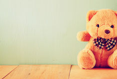 Teddy bear on wooden table Stock Photo