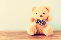 Teddy bear on wooden table. retro filter. Royalty Free Stock Photography