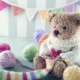 Teddy bear in a woolen sweater Stock Photography