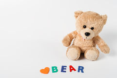 Teddy Bear with the words `love bear`. On white background Stock Image
