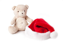 Teddy bear and xmas cap Stock Images