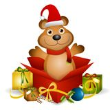 Teddy Bear Xmas Gift. An illustration featuring a teddy bear sitting in an unwrapped Christmas present box Royalty Free Stock Images