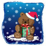 Teddy bear with Xmas present Royalty Free Stock Image