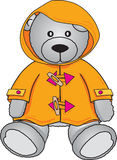 Teddy Bear in yellow coat. Cute Grey bear in yellow hooded coat Stock Photography