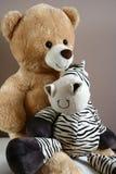 Teddy bear with zebra friend Stock Photography