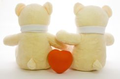 Teddy bears. Back view of a pair of teddy bears with a red heart Stock Images