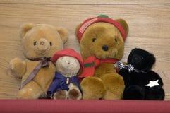 Teddy bears. Four teddy bears on a bench Royalty Free Stock Photo