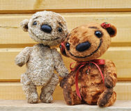 Teddy bears against a wooden wall Royalty Free Stock Images