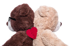 Teddy bears back to back for support : broken heart isolated on Royalty Free Stock Image