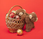 Teddy Bears and a basket with Christmas toys. Stock Photography
