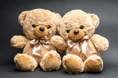 Teddy bears on black surface royalty free stock photos