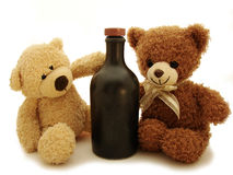 Teddy bears & bottle Royalty Free Stock Image