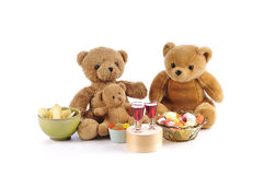 Teddy bears and bowls of candy Stock Image