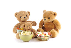 Teddy bears and bowls of candy Royalty Free Stock Image