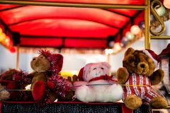 Teddy bears with Christmas light bokeh. Cute three Teddy bears with red Santa Claus hat decoration with Christmas light bokeh bakehground and copy space for text Stock Photos