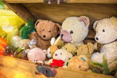 Teddy bears in a dark box of Christmas decorations. And gifts Royalty Free Stock Images