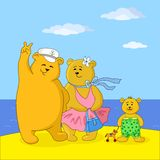 Teddy bears family on a beach. Family of toy teddy bears, mum, father and son on a sea beach Stock Photos