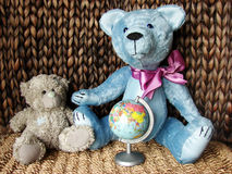 Teddy-bears & globe Royalty Free Stock Image