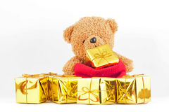 Teddy bears with gold gift box in the Christmas or New Year festival. Teddy bears with gift box in the Christmas or New Year festival Royalty Free Stock Image