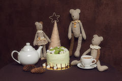 Teddy bears, green pistachio cake with macaroons and marshmallows Stock Photo