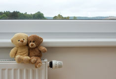Teddy bears on the heater Royalty Free Stock Images