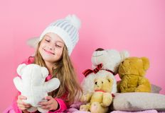 Teddy bears help children handle emotions and limit stress. Child small girl playful hold teddy bear plush toy. Kid. Little girl play with soft toy teddy bear royalty free stock photography
