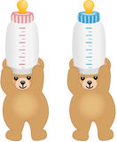 Teddy bears holding pink and blue bottle milk Royalty Free Stock Images