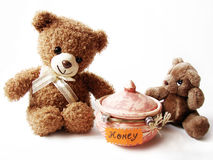 Teddy bears & honey Royalty Free Stock Photos