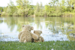 Teddy bears at the lake Royalty Free Stock Photography