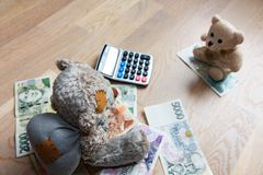 Teddy bears and money Stock Photo