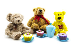 Teddy bears picnic. With tea and cakes over a white background Royalty Free Stock Photos