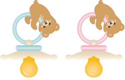 Teddy bears with pink and blue baby pacifiers Stock Photography