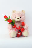 Teddy bears, pink and red roses. Stock Photos
