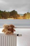Teddy bears on radiator Stock Photography
