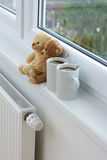 Teddy bears on radiator Stock Images
