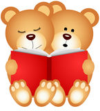 Teddy bears reading a book Stock Image