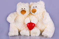 Teddy bears with red heart isolated Stock Photo