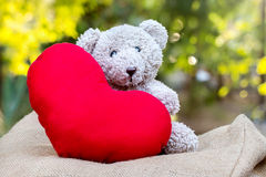 Teddy bears and red hearts Royalty Free Stock Photos