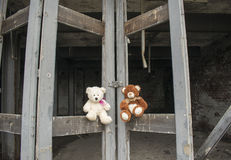 Teddy Bears Sitting On Abandoned Fie Station Bay Doors Foto de archivo libre de regalías
