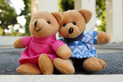 Teddy bears. Sitting in the garden Royalty Free Stock Image